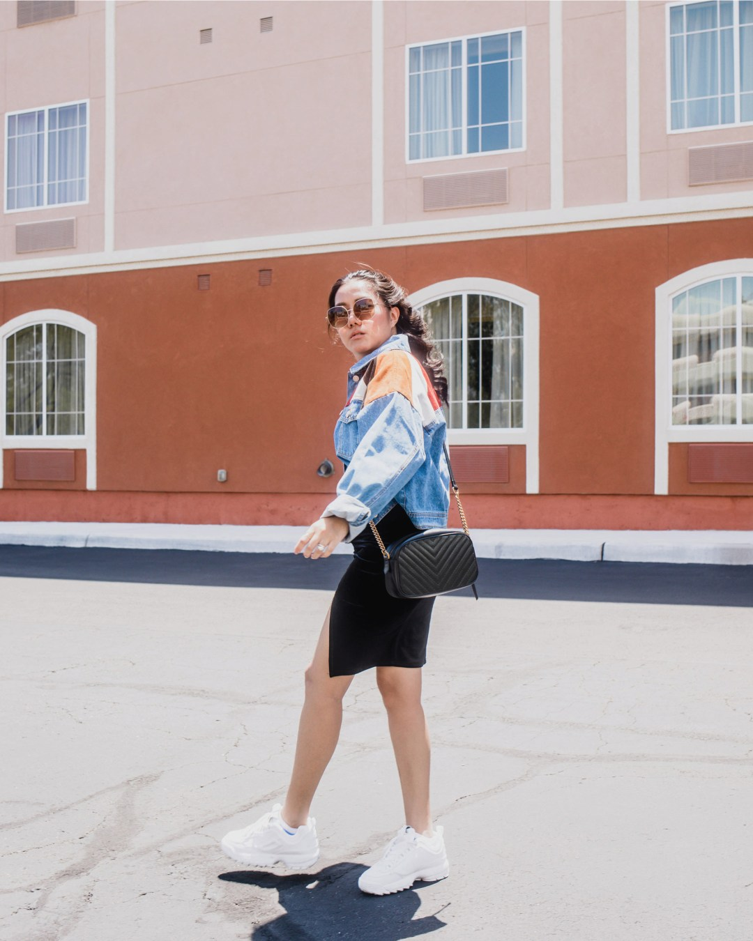 How-to-make-your-NWFW-chic-and-comfortable-with-Dr.-Scholl's-Stylish-Step_allaboutgoodvibes.com_denim jacket, black velvet dress, white sneakers, retro sunglasses, chevron bag outfit