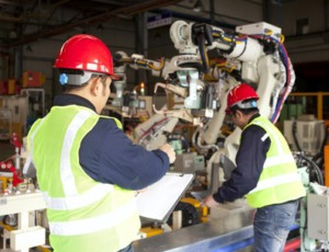 Factory workers team on working