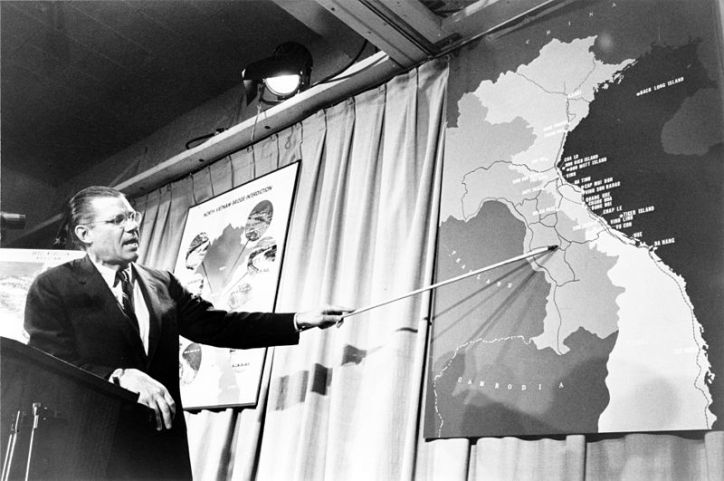 Robert McNamara pointing to a map of Vietnam
