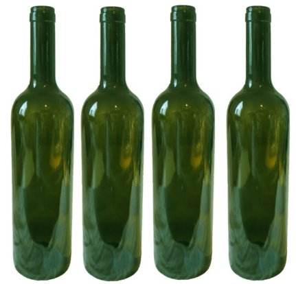 Four empty green wine bottles