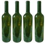 Four empty green wine bottles