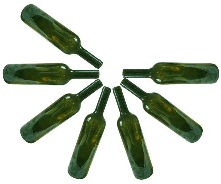 Seven empty green wine bottles
