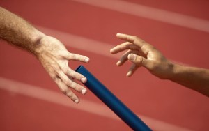 Relay Runner Passing Baton off to Next Runner
