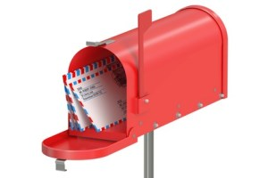 Red mailbox with letters isolated on white background