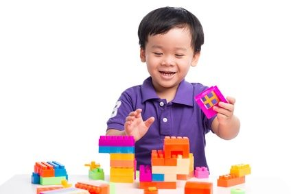 Boy making Lego Tower