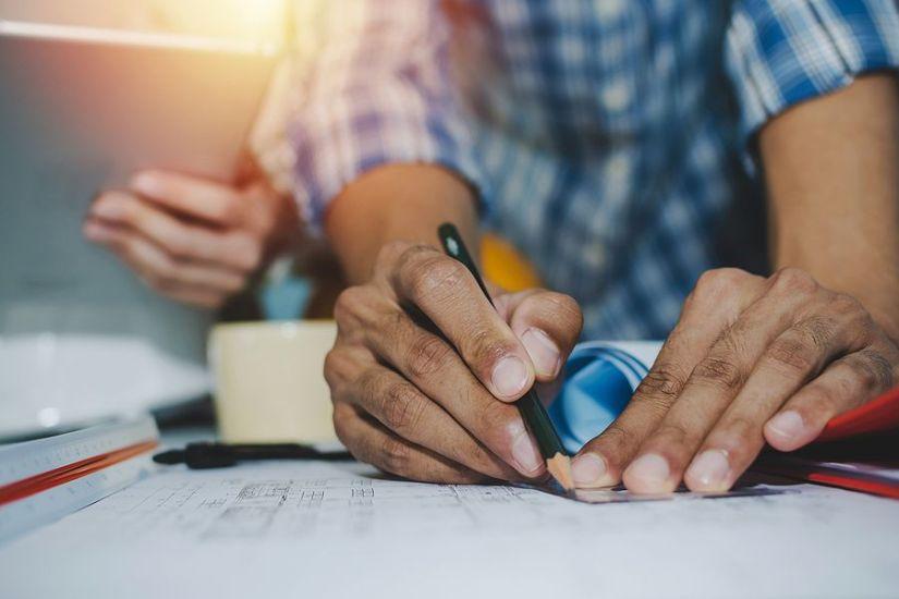 Engineering hands and blueprint