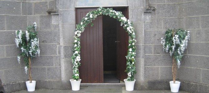 Church ceremony decor at St Cronins Church Lusmath in Offaly by All About Weddings.