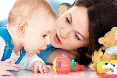 Baby with mother/freedigitalphotos