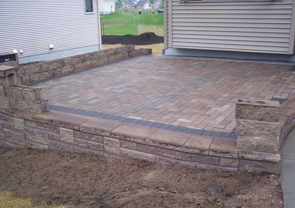 choose a flooring option like concrete pavers brick or natural stones to fit the design and style of your landscape