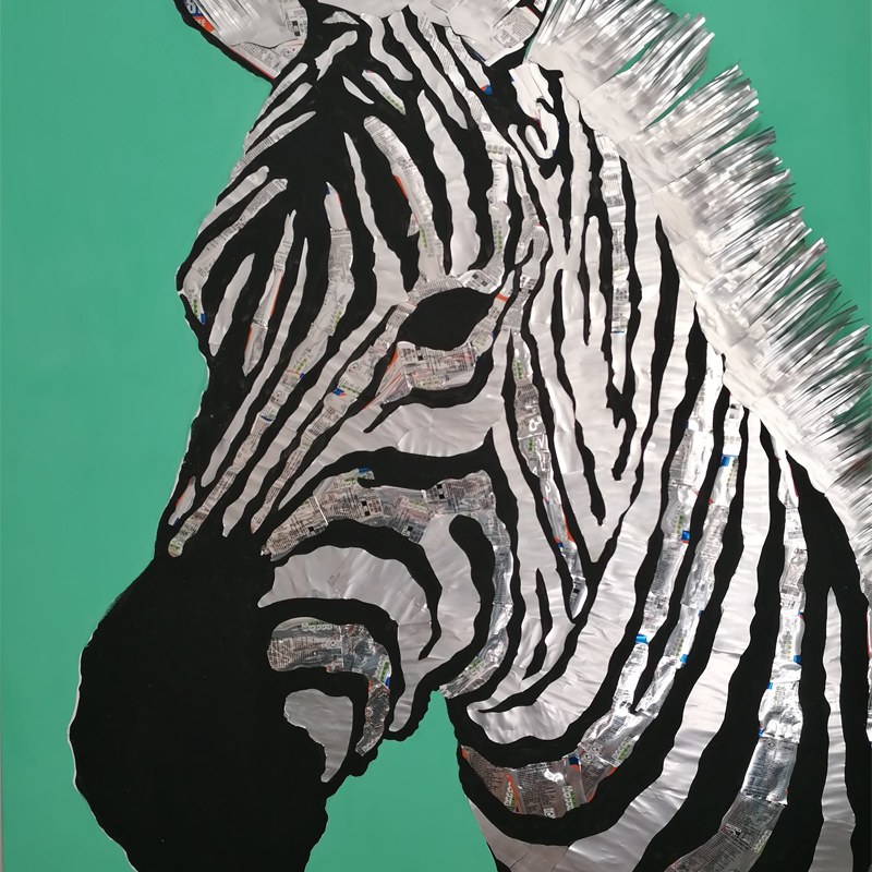 giant zebra made of recycled aluminium metal cans on green canvas