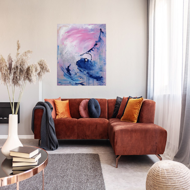Pink, purple and blue painting hanging in a modern livingroom