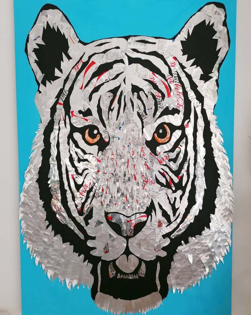 large tiger wall art made of metal drink cans on large blue canvas