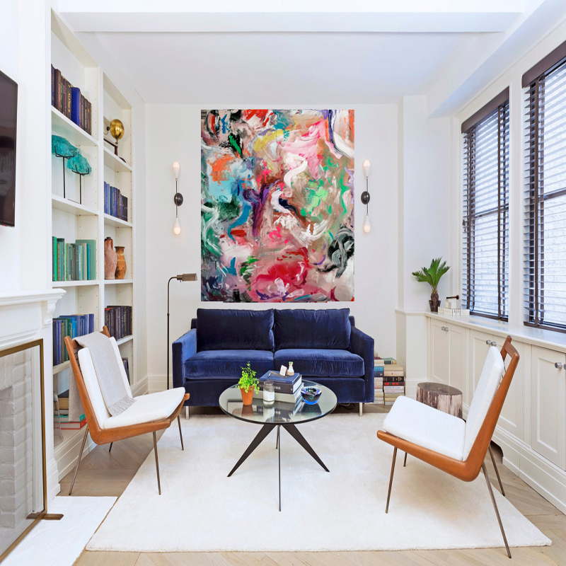 modern livingroom with multi coloured abstract painting hanging on the wall