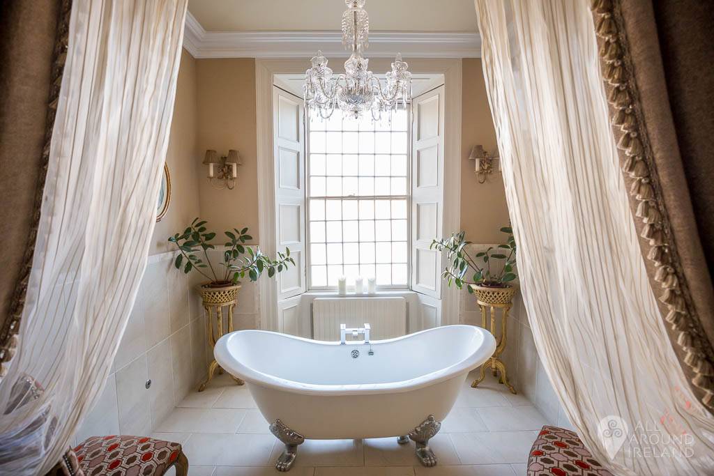 Claw foot bath with overhead chandelier. In one of the 12 luxury rooms within the main castle.
