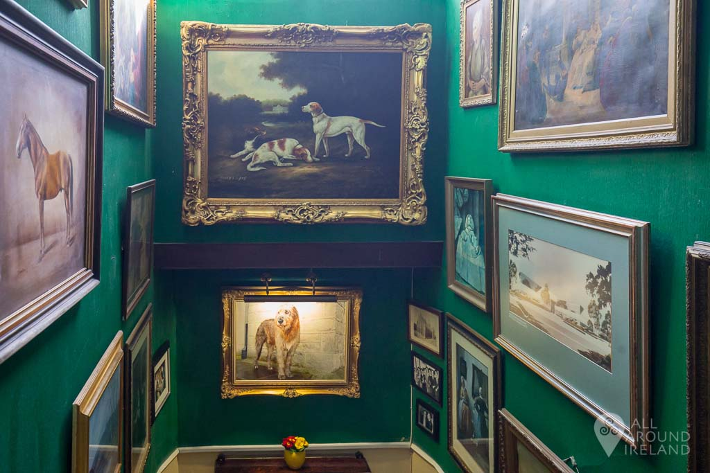 Gallery of portraits on the stairwell at Cabra Castle