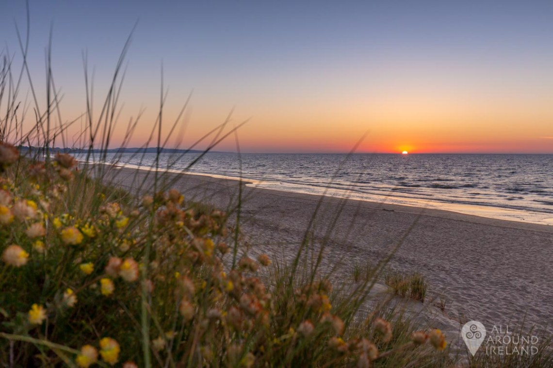 The sun breaking over the horizon, Curracloe Beach