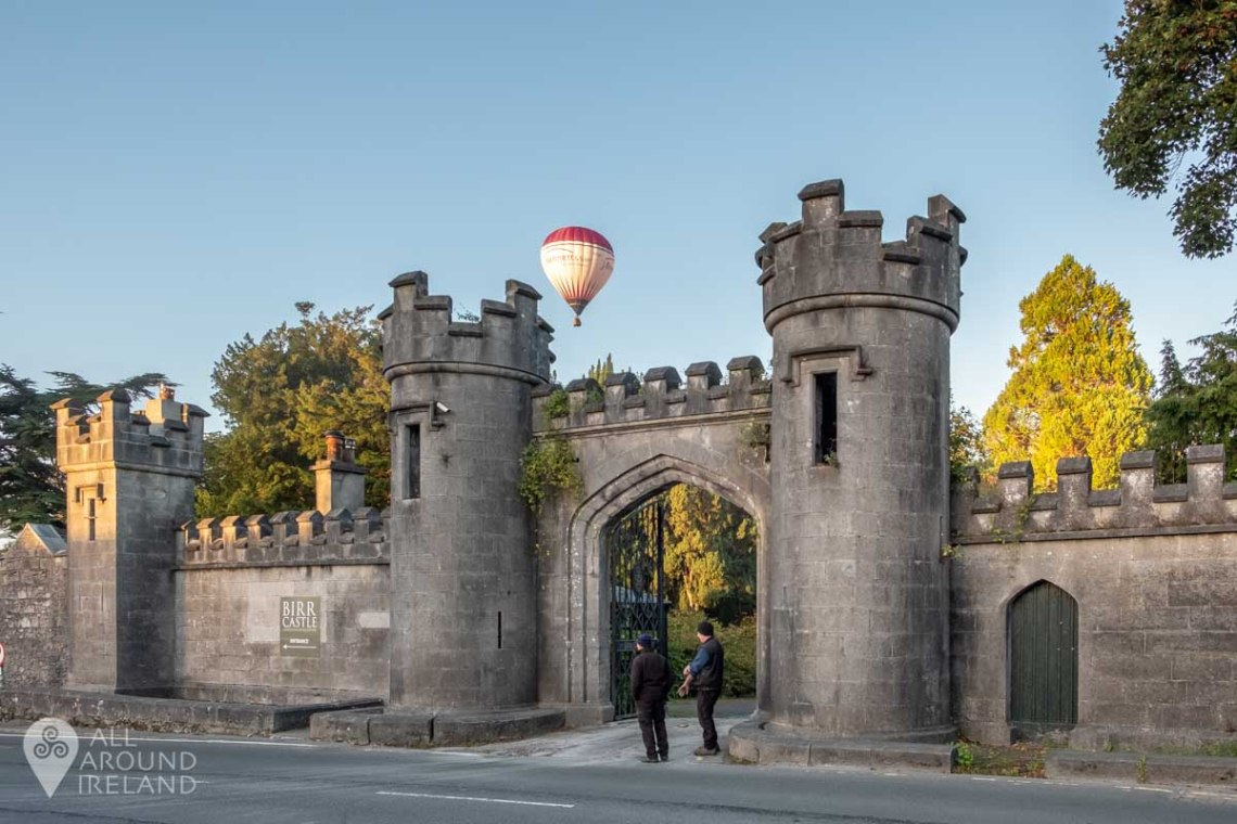 A hot air balloon floats above Birr Castle gates. Irish Hot Air Ballooning Championships 2018.