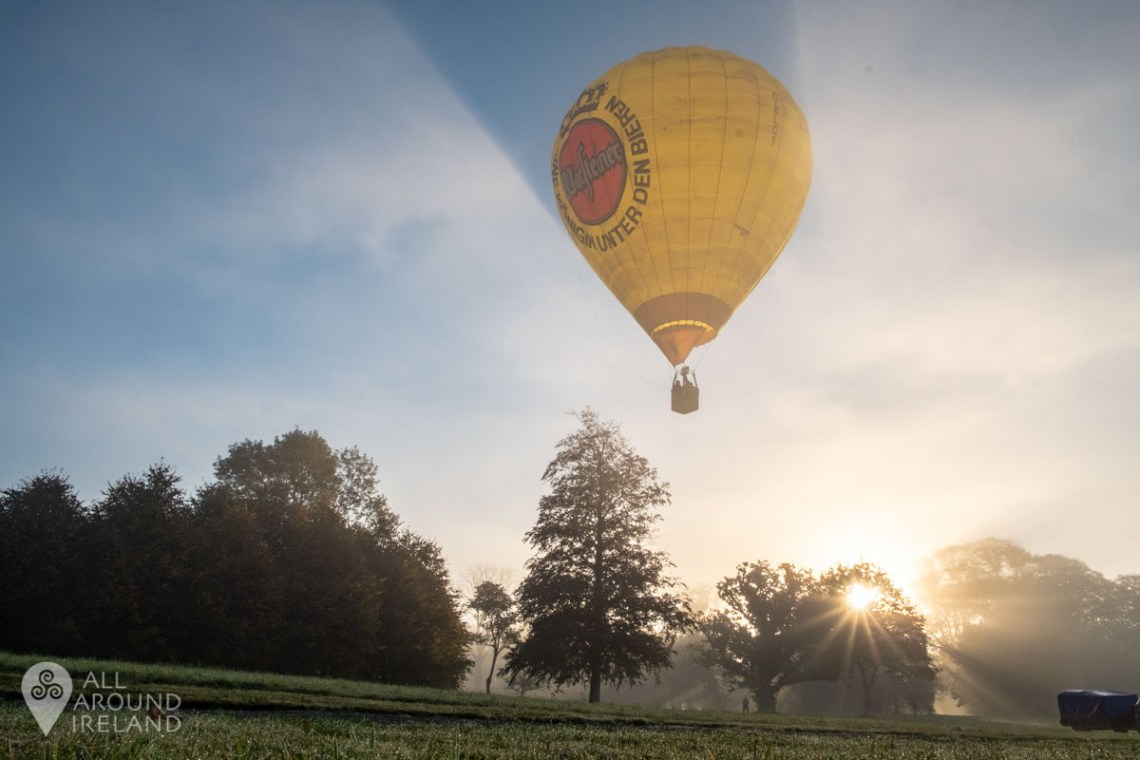 A balloon launches from Birr Castle in the early morning light and fog. Irish Hot Air Ballooning Championships 2018.