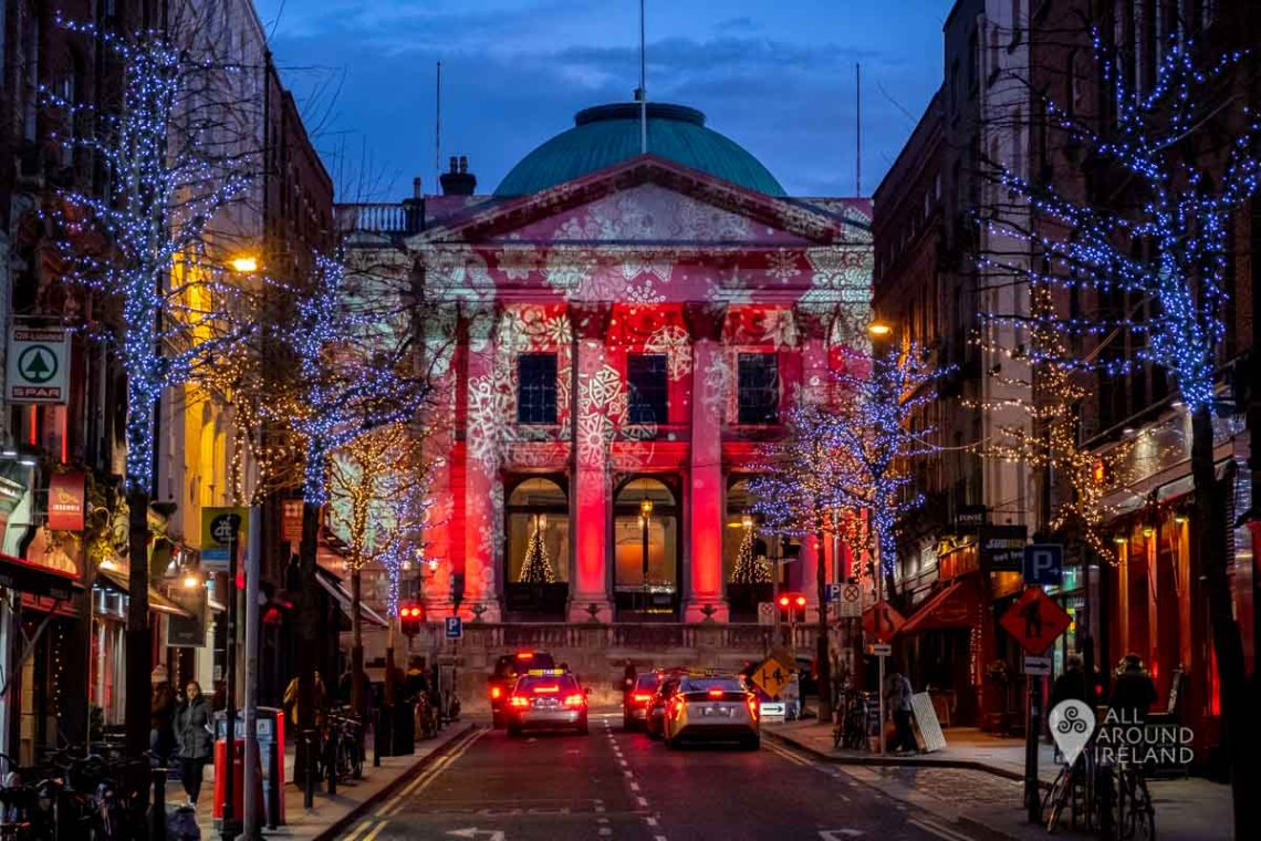 Dublin City Hall illuminated in red with moving snow flakes as part of Winter Lights Dublin City