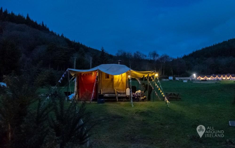 Bosca Beatha mobile sauna lit up at dusk in Glenmalure Valley
