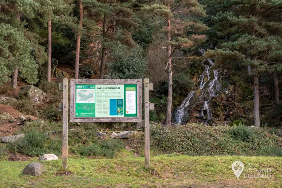 Signpost in Ballinafunshoge carpark with waterfall in the background