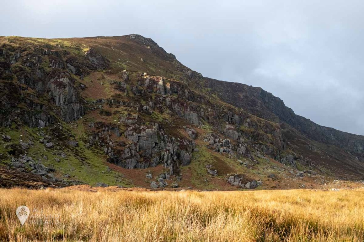 Golden light on the highest peak surrounding Mahon Falls in the Comeragh Mountains
