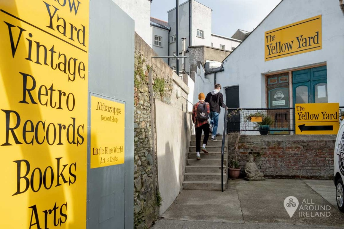 Two young men walking up the stops to enter The Yellow Yard market in Derry