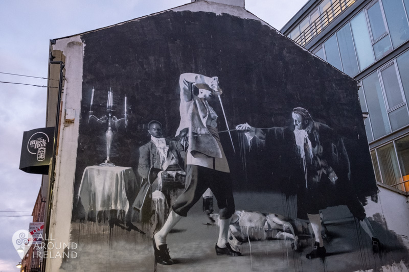 A black and white mural of a duel in the Cathedral Quarter