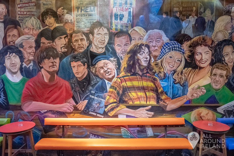A mural of famous people in the Cathedral Quarter