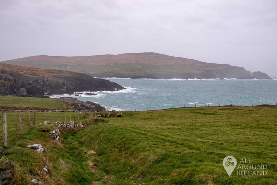 Views of the rugged Irish coastline and the Atlantic ocean on the way to Dunlough Castle