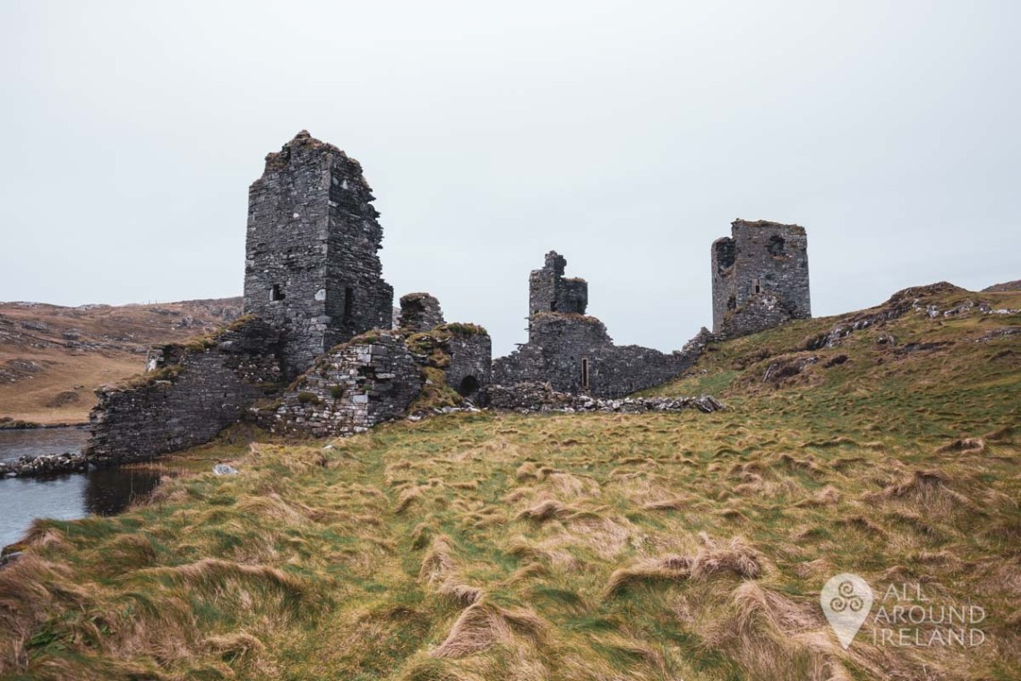 Looking back at the ruins of Dunlough Castle from the lakeshore