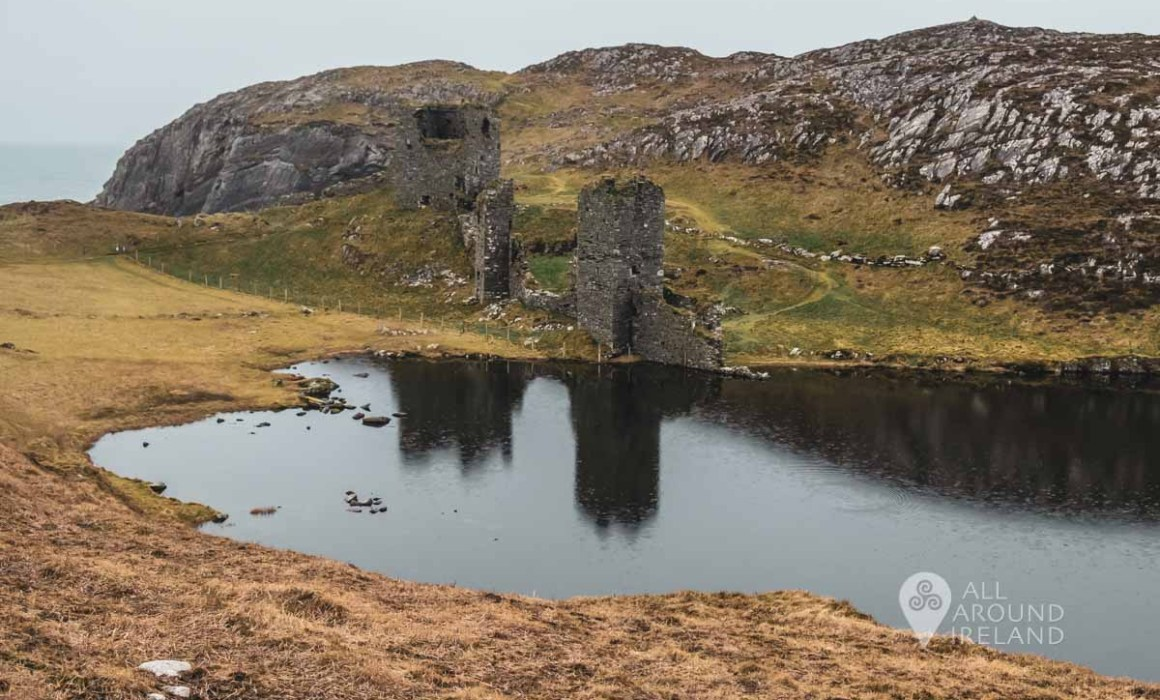 Dunlough Castle reflected in the lake