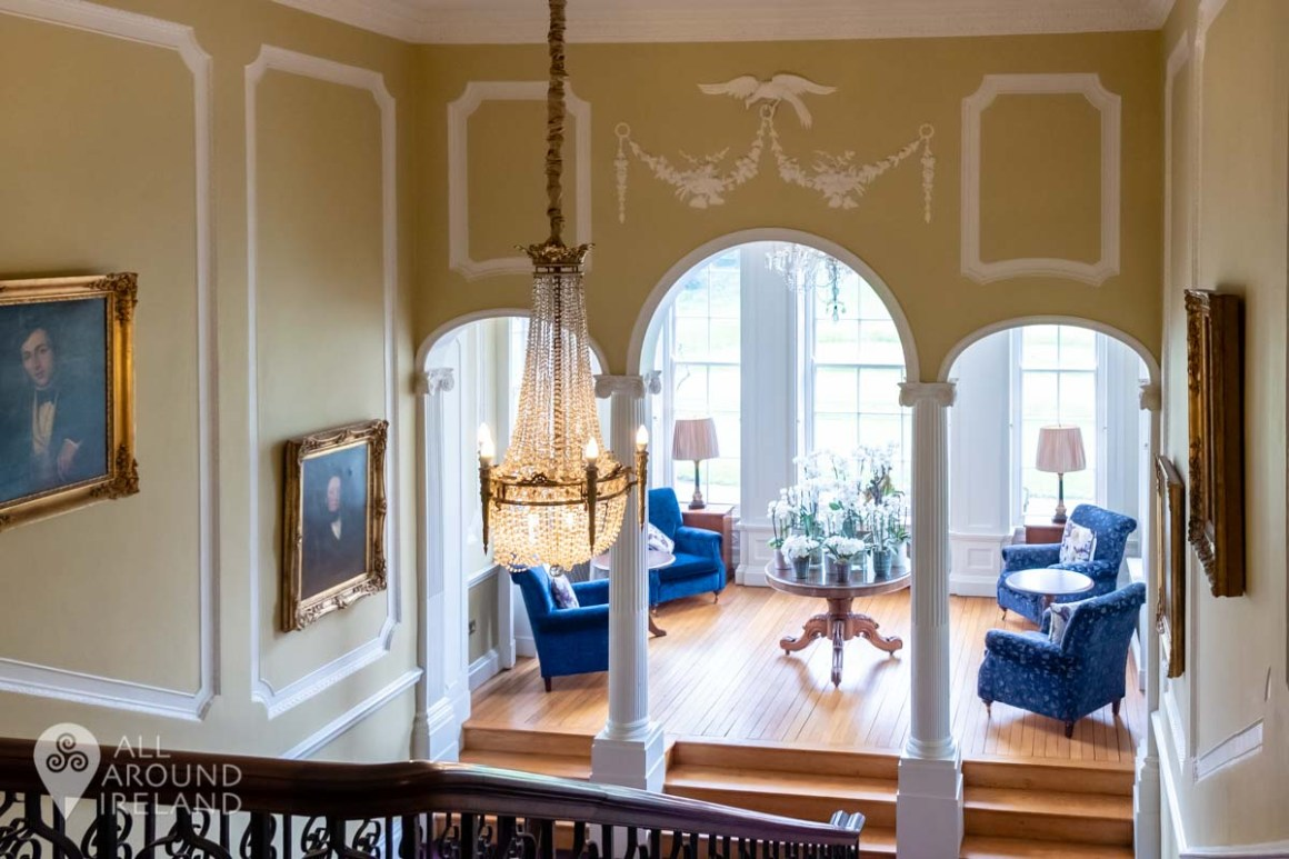 Landing area in the manor house with large windows and chairs to relax and read