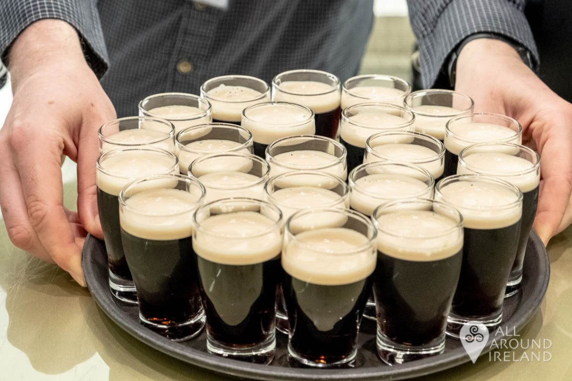 A tray full of baby pints of Guinness in the tasting rooms
