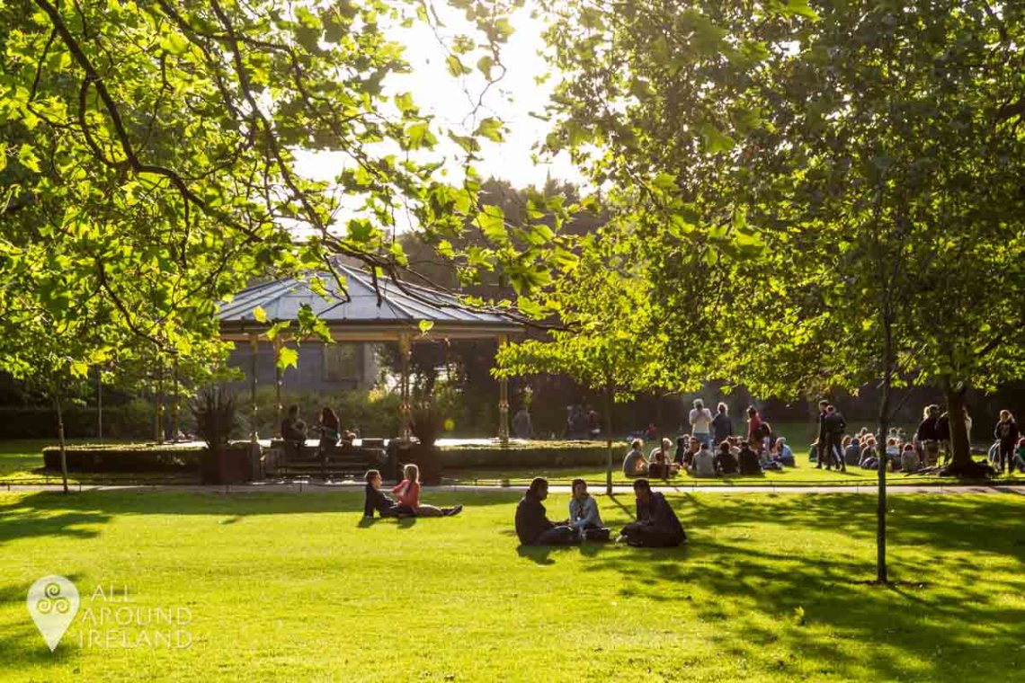 People enjoying a sunny evening in St Stephen's Green
