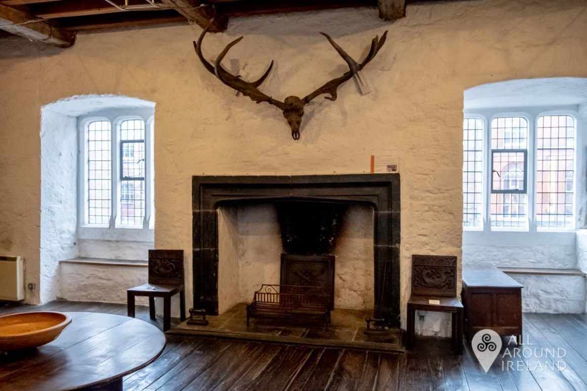 Skull and antlers of Giant Irish Deer over the fireplace in the Phelan Room