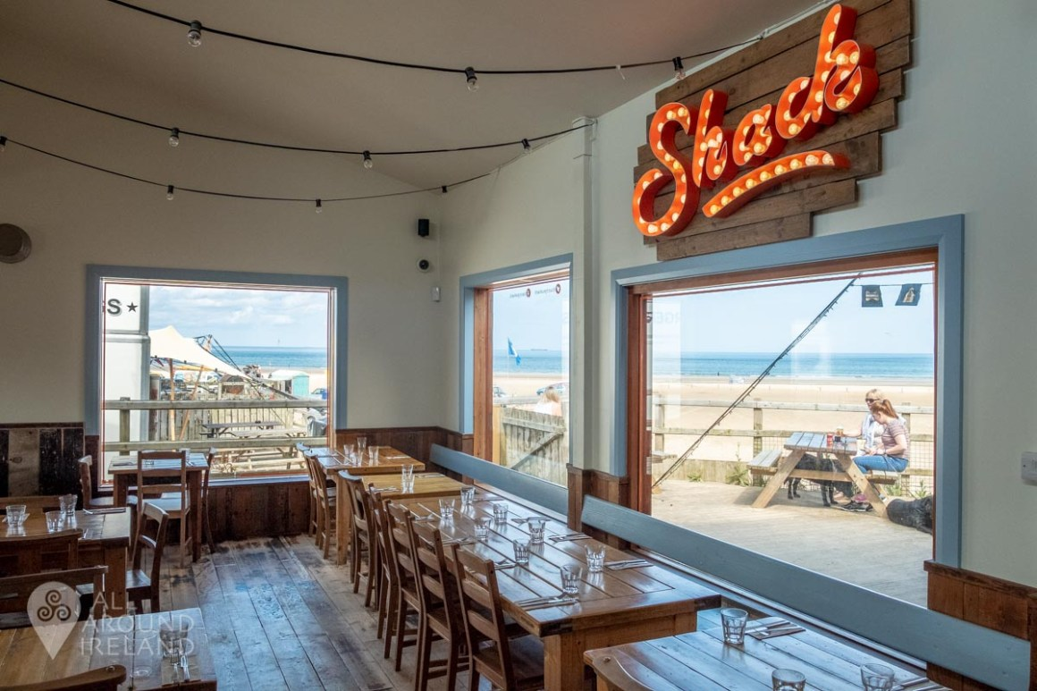 Interior shot of Harry's Shack on Portstewart Strand with views over the beach