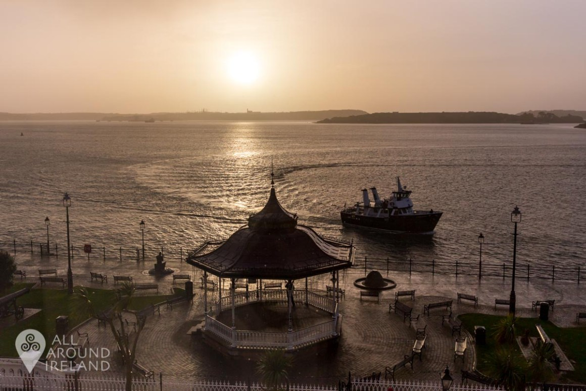View from the Commodore Hotel in Cobh. Looking down on the bandstand in Kennedy Park as a ship sails by in the background.
