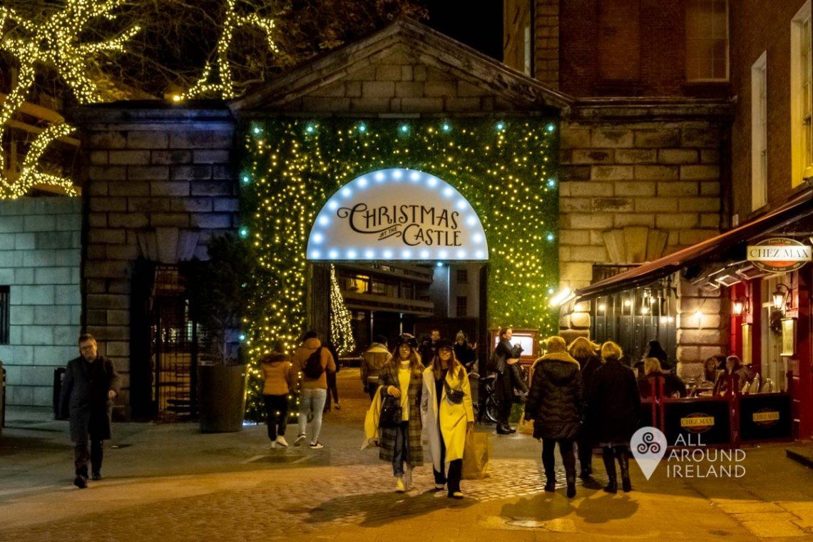 People coming and going at the entrance to the Dublin Castle Christmas Market