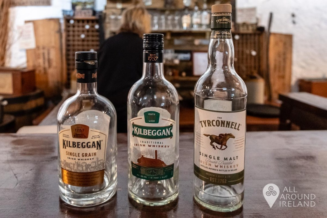 Three types of whiskey lined up on the bar for tasting