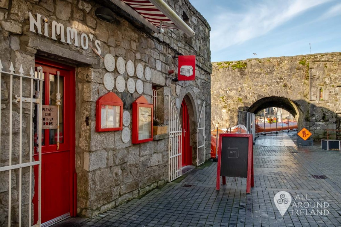 The entrance of Ard Bia at Nimmo's with the Spanish Arch to the right of the image and blue sky above.