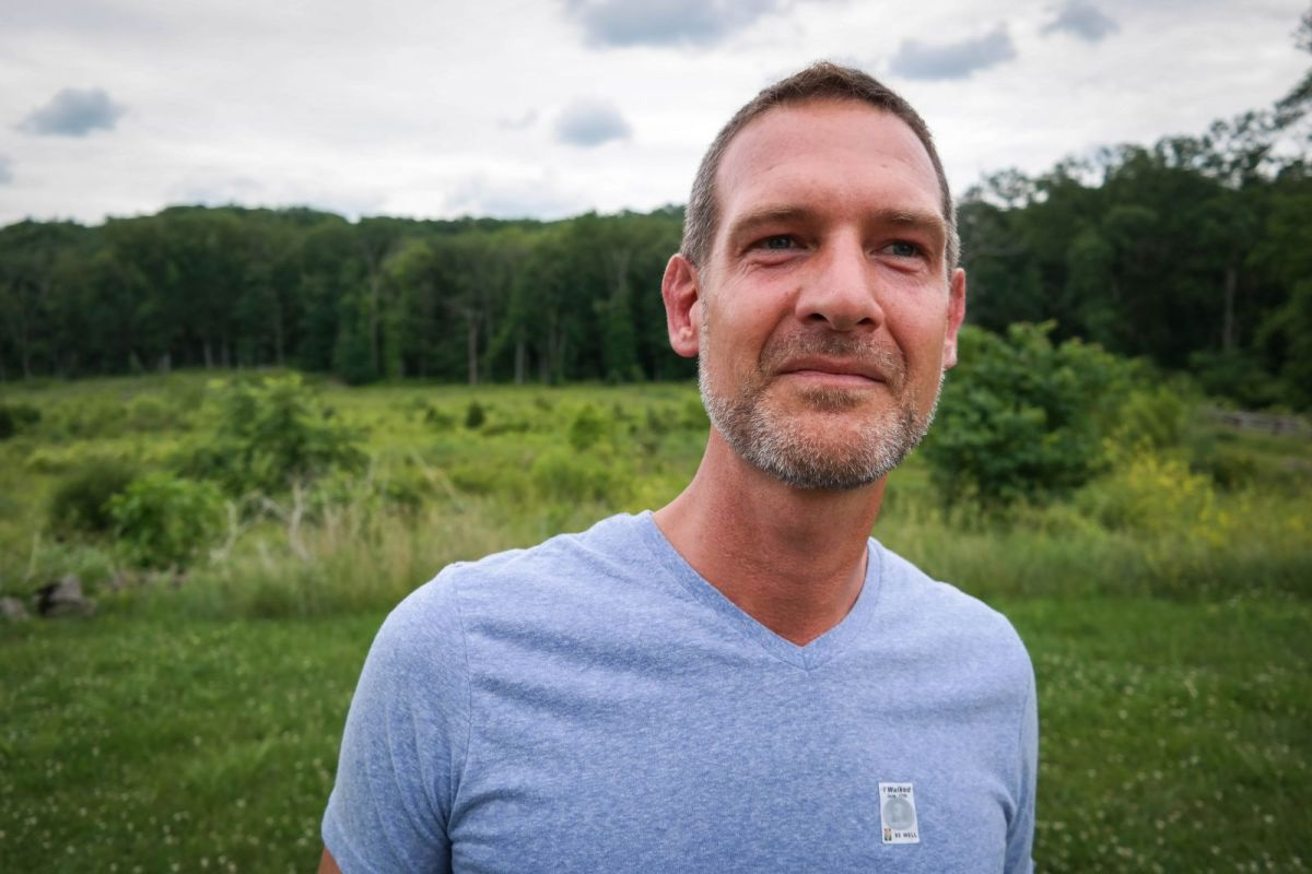 Gettysburg Chief of Resource Management, Zach Bolitho, stands on the Slyder Farm near Devil's Den, Gettysburg National Military Park, June 17, 2015. Photo: Lou Blouin