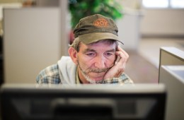 Unemployed coal miner Eddie Jones looks for jobs on a computer at the Kentucky Career Center in Harlan, Kentucky. With no computer at home, he goes to the employment office two or three times a week to see what's available. In the meantime, Jones has been making do with odd jobs, painting, digging ditches, mowing grass. Photo: AP / David Goldman