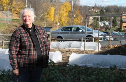 Pat Eagon stands outside the garden near the South Hills Interfaith Ministries food pantry in Pittsburgh. Last year, Eagon helped grow 15,000 pounds of fresh produce for the pantry. Photo: Julie Grant
