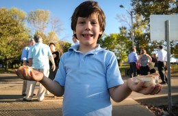 Sam Berman, 6, from the Temple Sinai in Pittsburgh, gets ready for the Tashlich ceremony held during Rosh Hashanah, the Jewish new year. During the service, bread is thrown in the river to symbolize the letting go of sins from the previous year. Photo: Lou Blouin