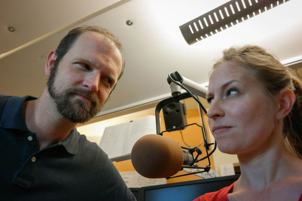 WESA radio hosts Josh Raulerson and Larkin Page-Jacobs have an ongoing feud over the temperature in the on-air studio. She likes it warmer, he likes it cooler—which is not an uncommon disagreement among men and women in shared work spaces. Photo: Lou Blouin
