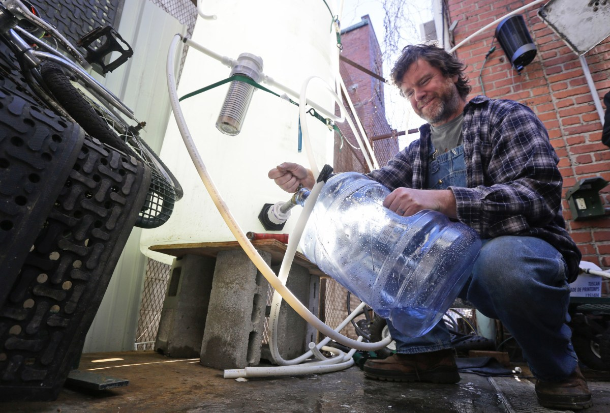 The 2014 toxic chemical spill in Charleston, West Virginia affected the water supply for more than 300,000 West Virginians and shut down schools, businesses and local governments. In this photo, Jonathan Steele, owner of Bluegrass Kitchen, fills a jug with cleaning water in the back of his restaurant. Steele installed a large tank in the back of his restaurant and was able to open his restaurant using bottled water. Photo: Steve Helber / AP
