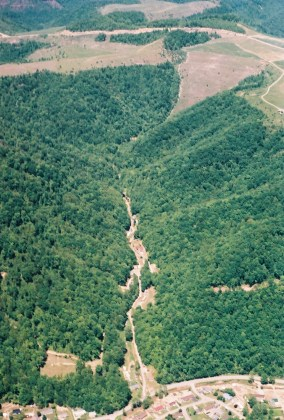 Surface mining done for the King Coal Highway above Pigeon Creek. This photo shows a valley fill at the headwaters of a tributary to Pigeon Creek and it was taken in the days after a major flood in the area. Photo Courtesy of Jack Spadaro