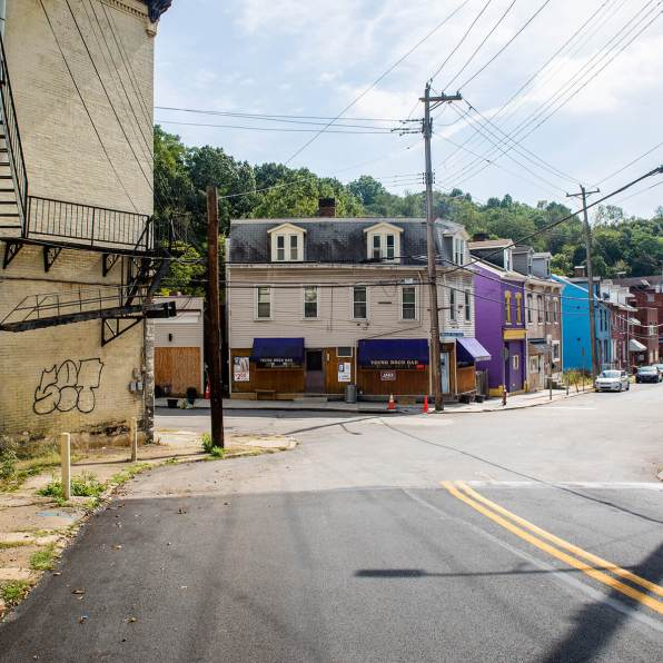 Jamie Younger owns and operates Young Brothers Bar, pictured on the corner of Woods Run and McClure avenues, on the border of the Woods Run and Brighton Heights neighborhoods of Pittsburgh. Young Brothers sits about a mile from the county's ALCOSAN water treatment facility. Photo: Njaimeh Njie