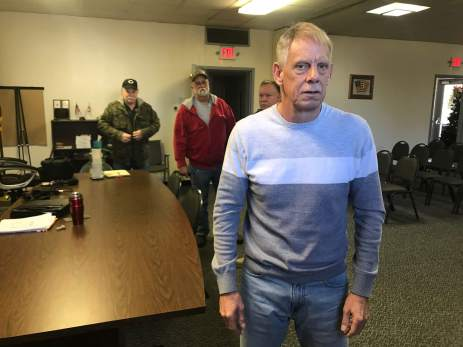 Edward Anthony, a trustee in Ohio's Warren Township, pictured at the township office along with residents who oppose removing the Leavittsburg dam. (Photo by Julie Grant/The Allegheny Front)